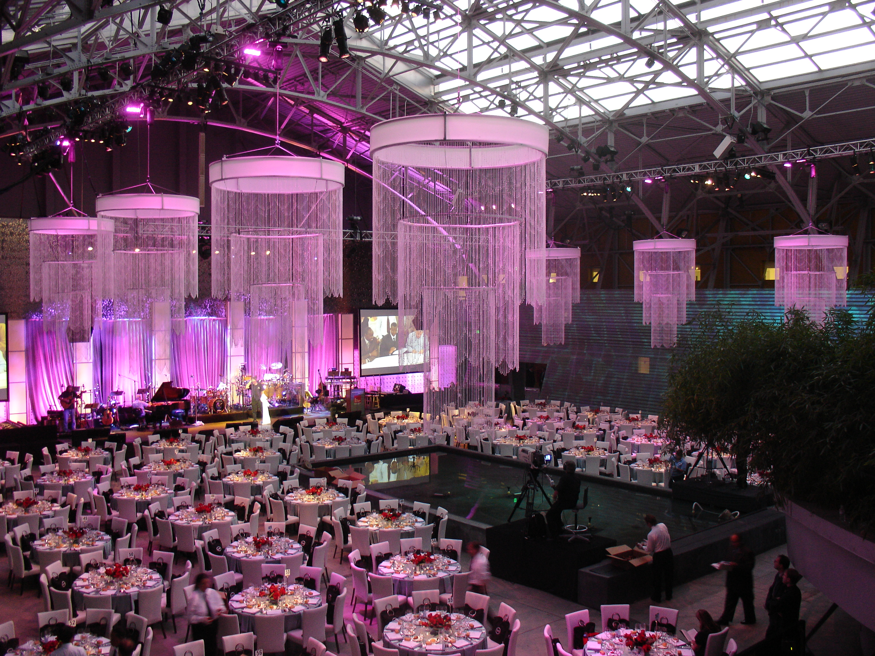 Purple Hued Wallis Annenberg Building Big Lab with hanging chandeliers and seated dinner
