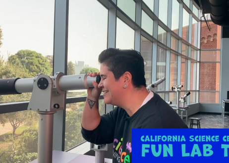 Educator Monica with telescope