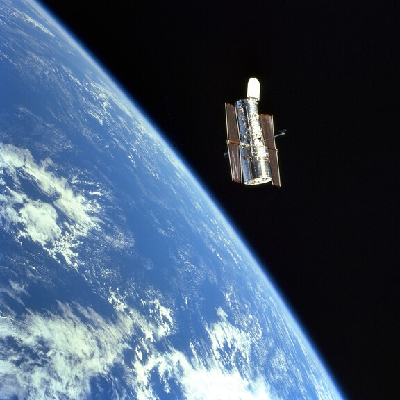 The Hubble space telescope orbits above Earth.