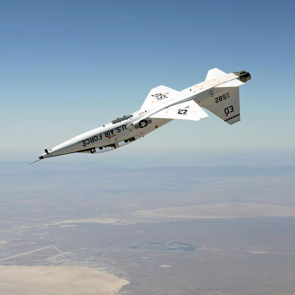 A T-38 Talon jet flies upside down