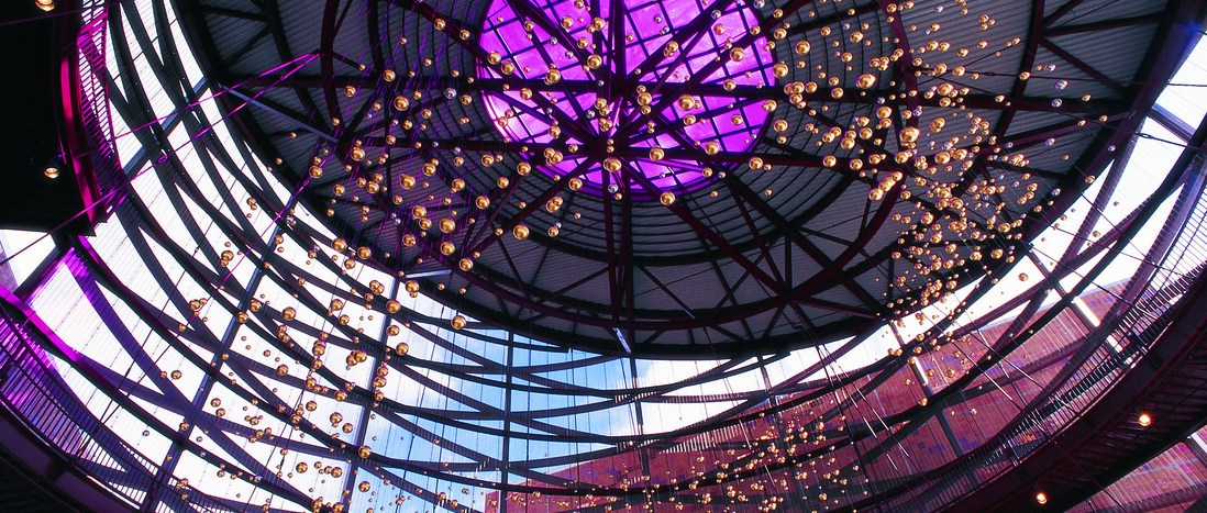 Looking up at the The Aerial, a hanging sculpture of 1,578 gold and palladium balls inside the Robert H. Lorsch Family Pavilion at the California Science Center.