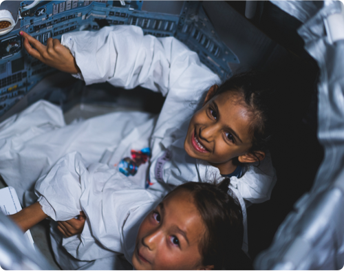 Two girls in a spaceshuttle